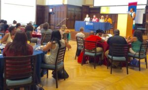 staff sit and listen at a Penn department event in ARCH 208