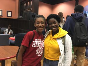 2 Students pose for a photo at the Houston Hall Open House