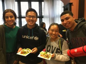 Four Penn Students pose with the food samples given out so they can try the new food at the Houston Market